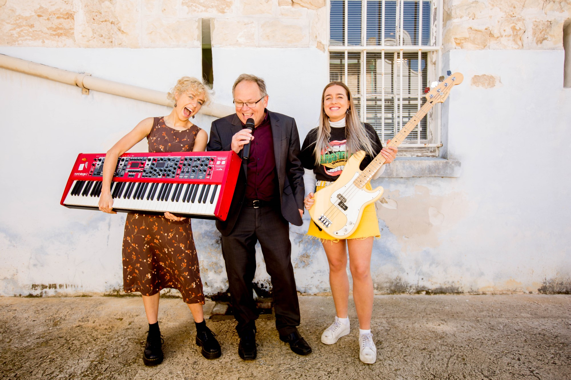 Culture and Arts Minister David Templeman with Ash and Timieka from Perth band Dulcie