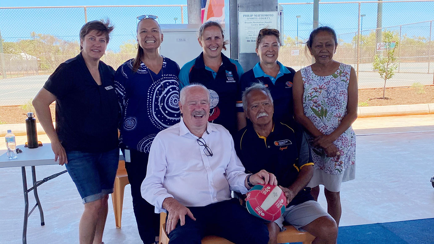 Minister Mick Murray with people at the Broome basketball courts