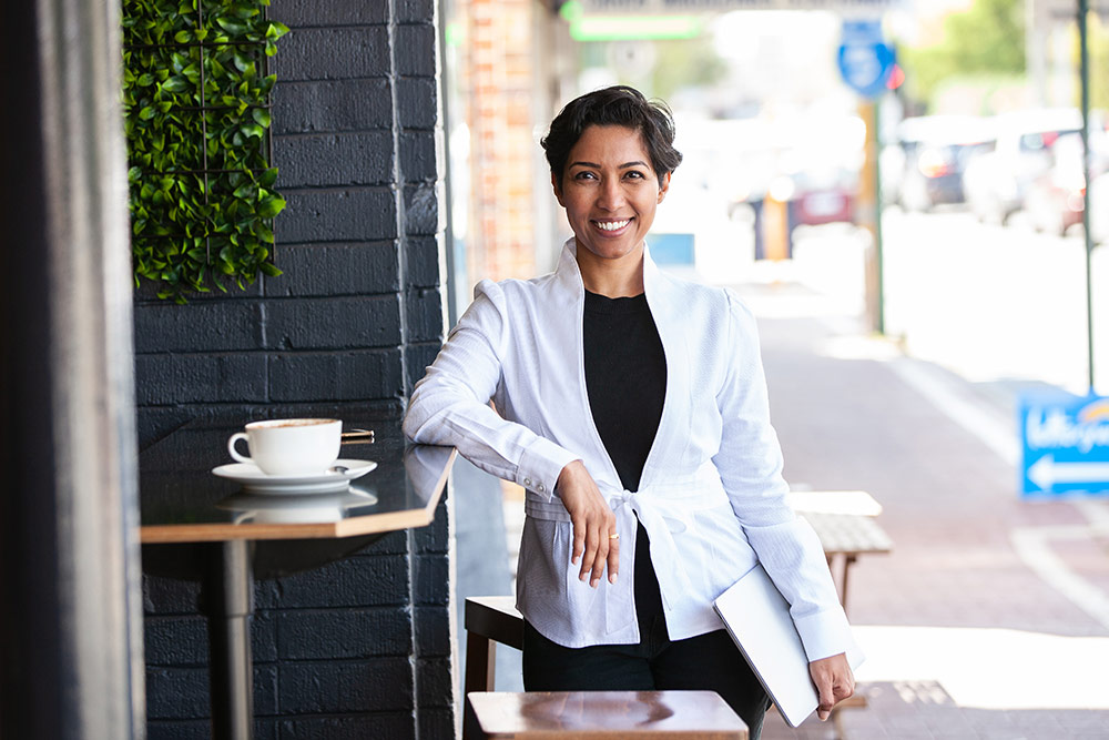 Portrait of confident business woman at coffee shop
