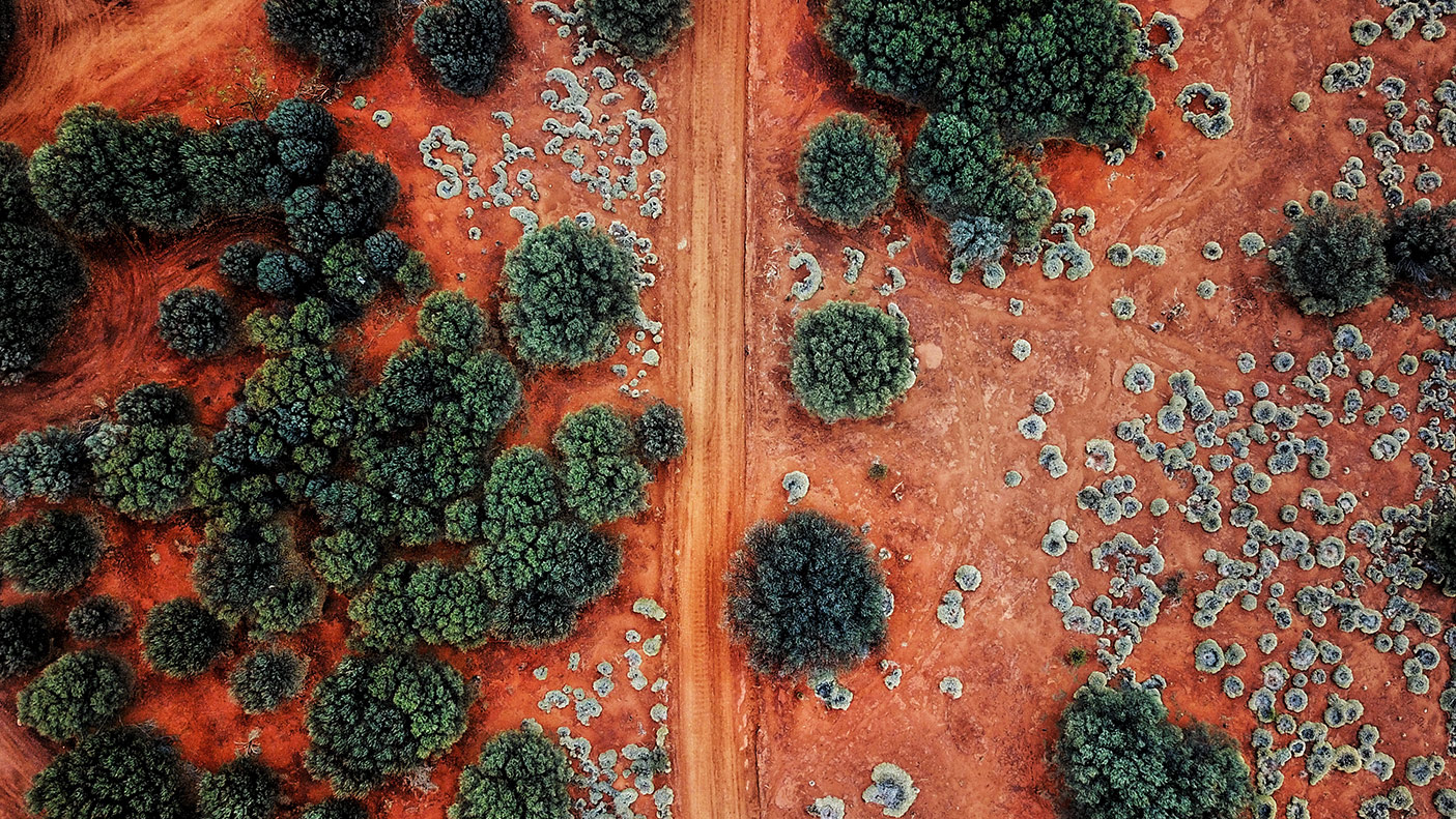 An Aerial shot of the red centre roads in the Australian Outback - stock photo