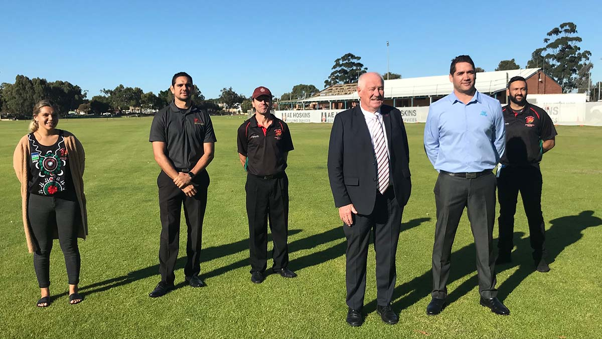 Minister joined by Nollamara football legend Des Headland and members of the Nollamara Football club