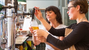 Learning to pour a beer behind the bar