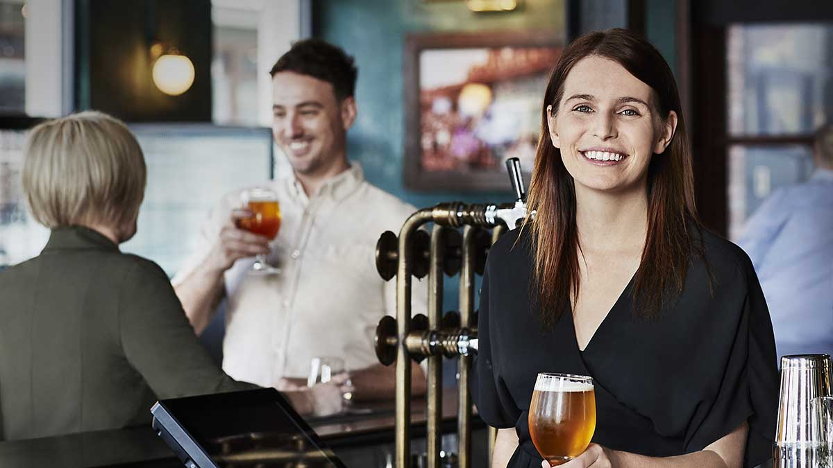 A bartender with patrons