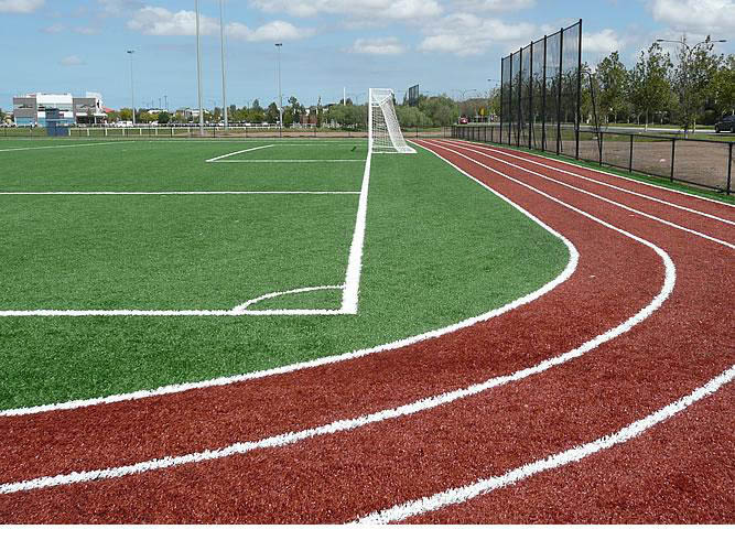 Synthetic soccer pitch and community school level athletics track