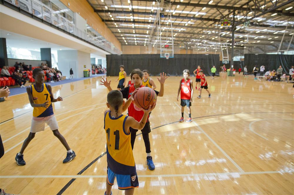 NAIDOC Basketball competition with paricipants playing at the Bendat Basketball Centre