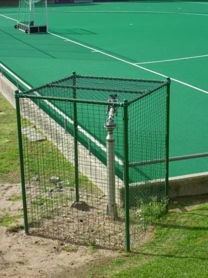 Figure 1: Water-based un-filled synthetic hockey pitch surface and irrigation point