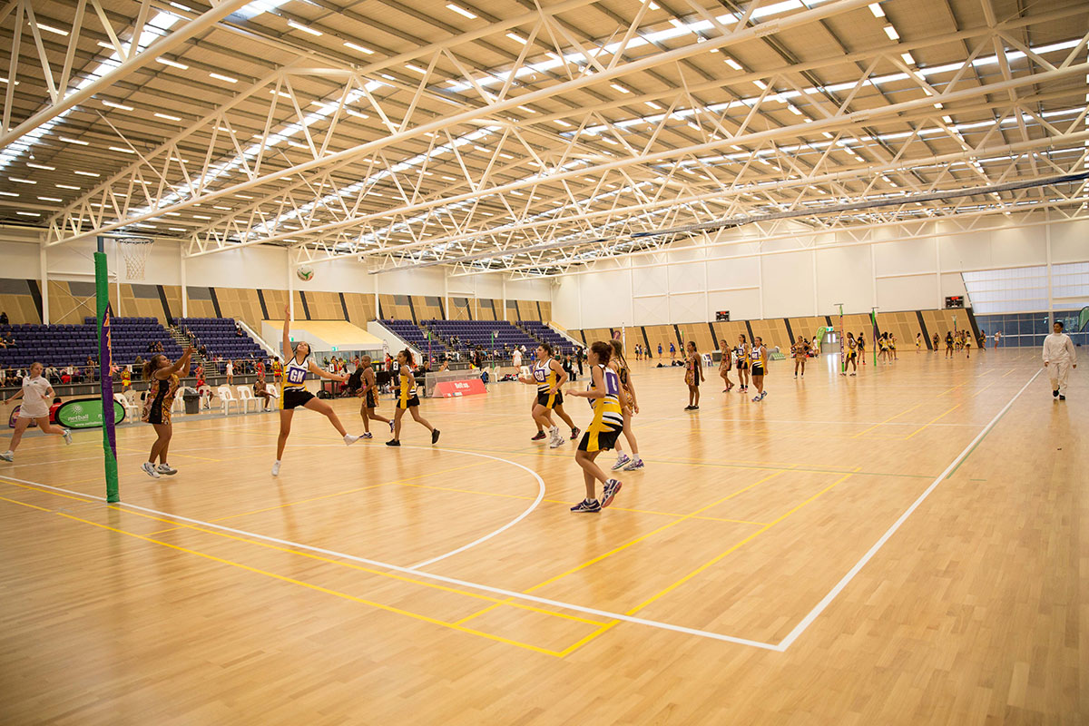 Netball players on court at the State Netball Centre during NAIDOC Week 2015