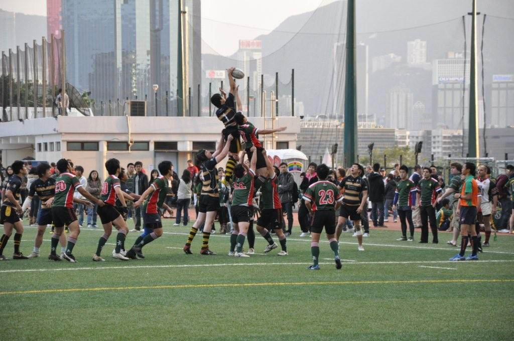 Rugby being played overseas on a synthetic turf field