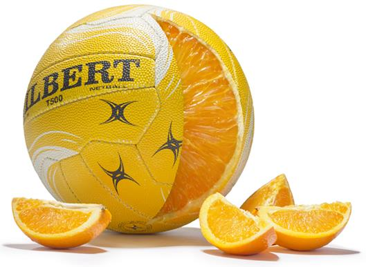 A netball that is cut open like an orange