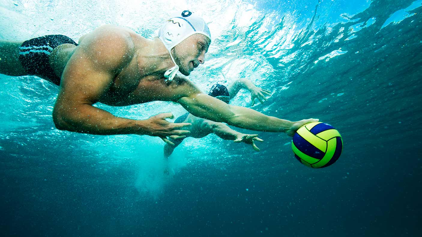 Water polo player with ball underwater